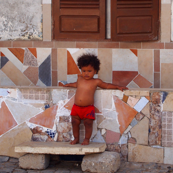 boy in front of his house